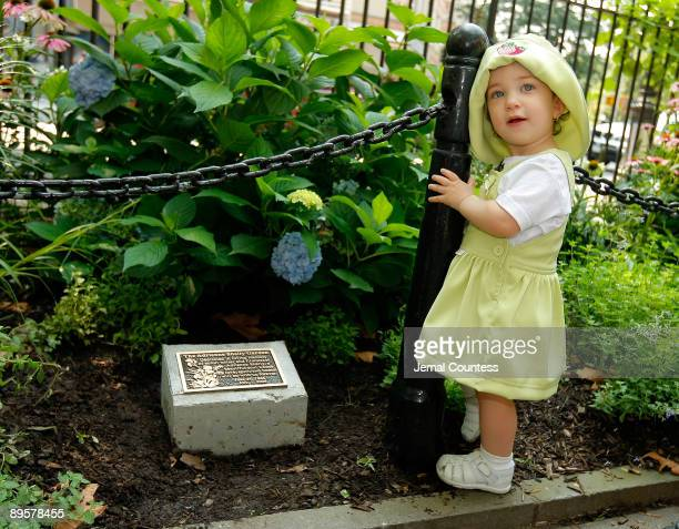 11 monthold Cayla Levine niece of writer/director Adrienne Shelly stands in front of the plaque dedicated in memory of Adrienne Shelly at the...