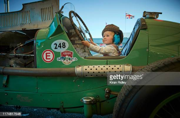 Month-old Georgia Ricketts sits in a 1934 ERA R3A once driven by the famous racing driver Raymond Mays, which her father maintains and looks after on...