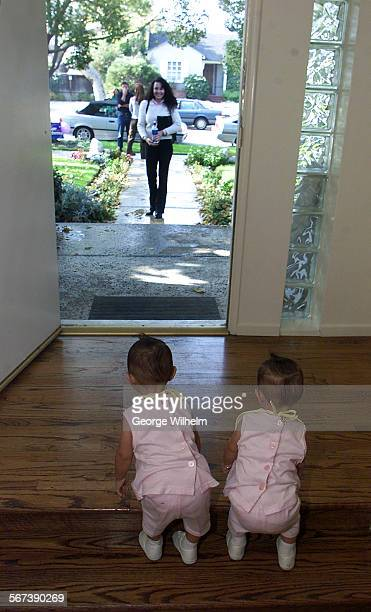 – 15–month–ols twins Cynthia and Samantha Gonzalez stand in the front doorway to Jimmy Wagner's Studio City home where a constant stream of hopefulls...