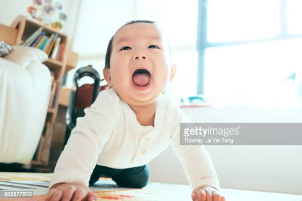 7 months old asian baby boy doing yoga on mat