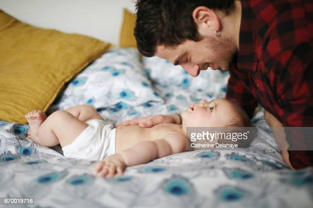 A 6 months old baby girl and her dad