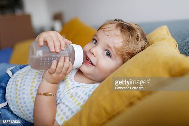 A 15 months old boy and his baby bottle