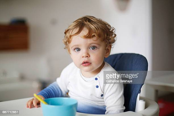 A 15 months old boy in his high chair