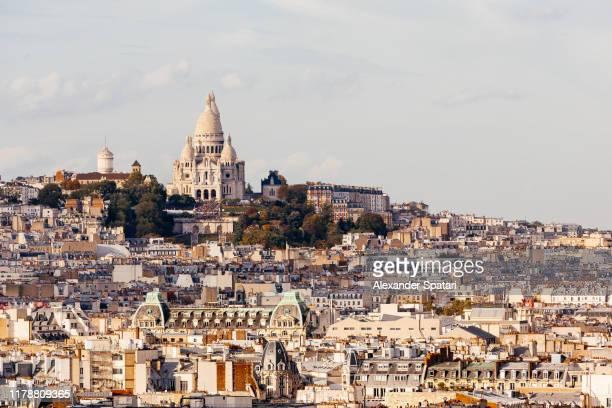 montmartre and sacre coeur basilica high angle view, paris, france - paris france stock pictures, royalty-free photos & images