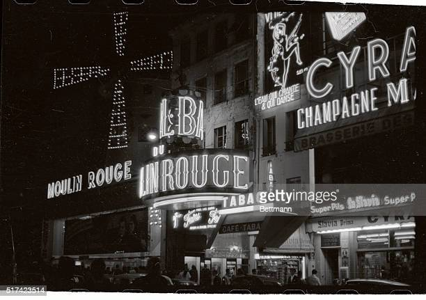 Montmartre district showing entrance to Moulin Rouge at night with neon lights glowing Undated photo Philip Gendreau Coll