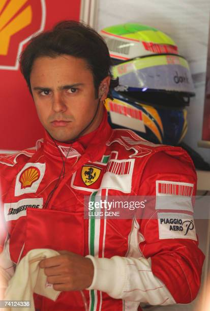 Brazilian Ferrari driver Felipe Massa prepares in the pits of the Catalunya racetrack in Montmelo 11 June 2007 during the first practise session of...