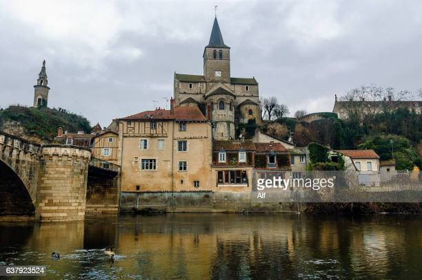 Montmorillon with the church of Notre Dame behind and the bridge over the Gartempe river, Nouvelle-Aquitaine, France