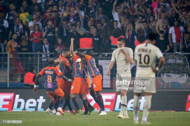 Montpellier celebrate the match winning goal by Souleymane Camara of Montpellier as Neymar of Paris SaintGermain looks on during the Montpellier Vs...
