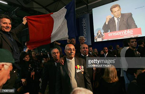 Harki veterans attend a French rightwing party UMP presidential candidate Nicolas Sarkozy's campaign meeting 03 May 2007 in Montpellier southern...