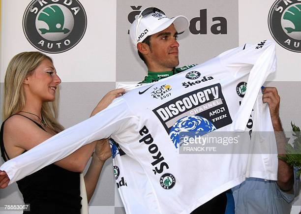 Spains Alberto Contador puts on the white jersey of best young rider on the podium of the 11th stage of the 94th Tour de France cycling race between...