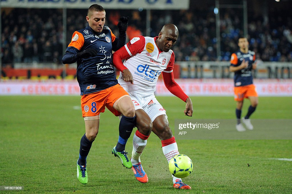 Montpellier midfielder Anthony Mounier (L) fights for the ball with Nancy defender Andre Joel Sami (R)on February 16, 2013 during a French L1 football match at the Mosson stadium in the southern Fr...