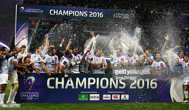 Montpellier players celebrate with the trophy following their team's 2619 victory during the European Rugby Challenge Cup Final match between...