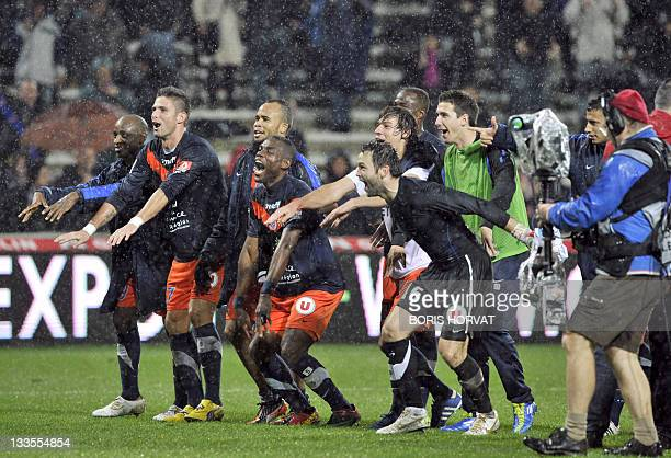 Montpellier players jubilate at the end the French L1 match Montpellier versus Marseille on November 19, 2011 at the Mosson stadium in Montpellier....
