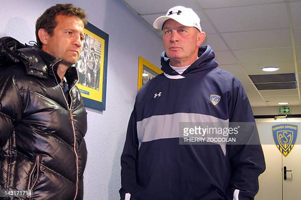 Montpellier rugby team's coach Fabien Galthie listens to Clermont's rugby team coach Vern Cotter from NewZealand prior to the French Top 14 rugby...