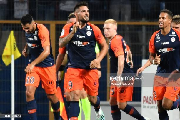 Montpellier's Algerian forward Andy Delort reacts after scoring during the French L1 football match between Montpellier Herault SC and OGC Nice at...