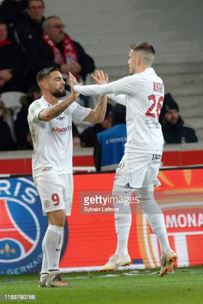 Montpellier's Andy Delort celebrates with team mate Mihailo Ristic after scoring goal during the Ligue 1 match between Lille OSC and Montpellier HSC...
