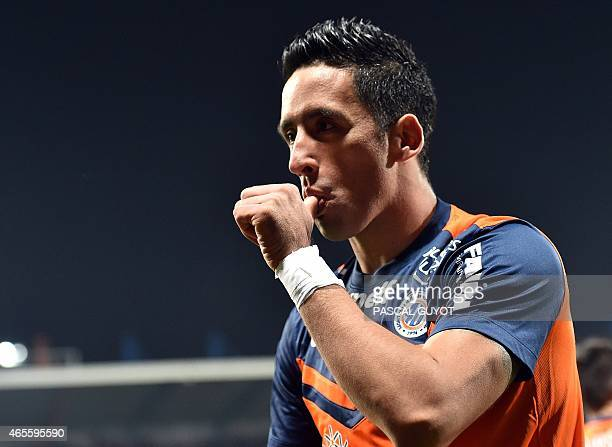 Montpellier's Argentine forward Lucas Barrios reacts after scoring a goal during the French L1 football match between Montpellier and Lyon on March 8...