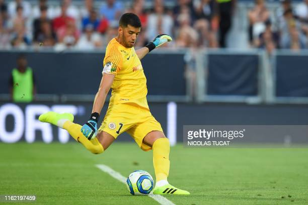 Montpellier's Argentine goalkeeper Geronimo Rulli passes the ball during the French L1 football match between FC Girondins de Bordeaux and...