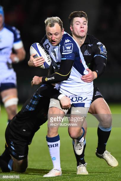 Montpellier's Australian fullback Jesse Mogg is tackled by Glasgow Warriors' Australian centre Sam Johnson and Glasgow Warriors' Scottish centre Huw...