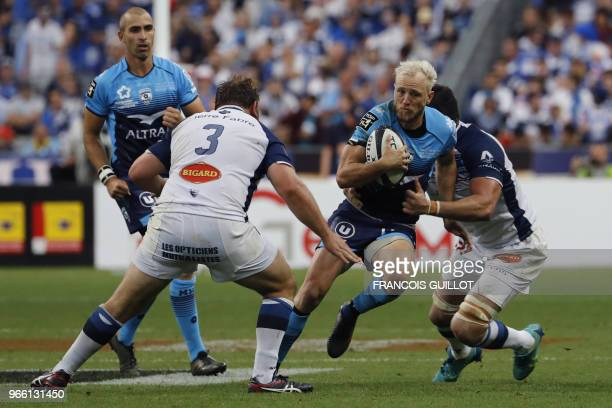 Montpellier's Australian fullback Jesse Mogg runs with the ball during the French Top 14 final rugby union match between Montpellier and Castres at...