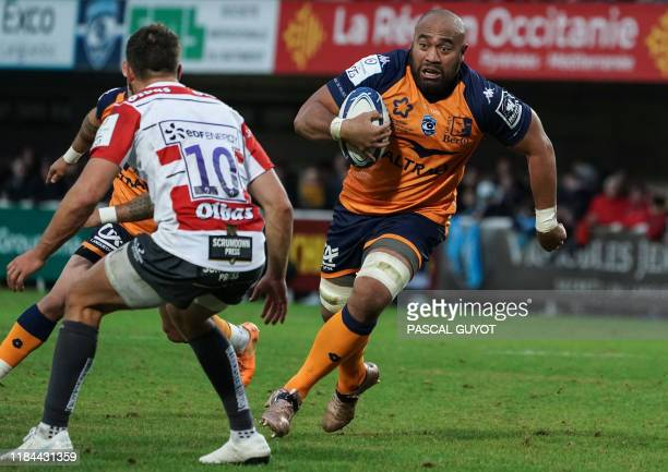 Montpellier's Australian number 8 Caleb Timu vies with Gloucester's English flyhalf Lloyd Evans during the European Rugby Champions Cup Pool 5 rugby...