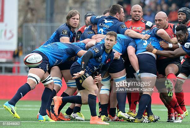 Montpellier's Australian scrumhalf Nic White clears a ball out of a scrum during the French Top 14 rugby union match Oyonnax vs Montpellier on March...