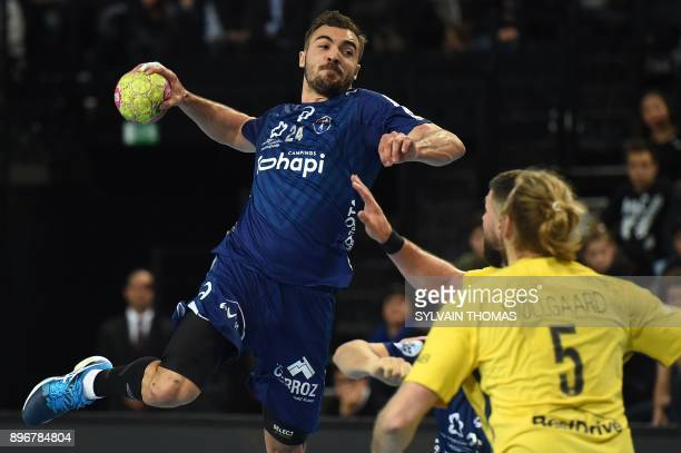Montpellier's Baptiste Bonnefond takes a shot during the French D1 handball match between Montpellier and Paris at Sud de France Arena on December 21...