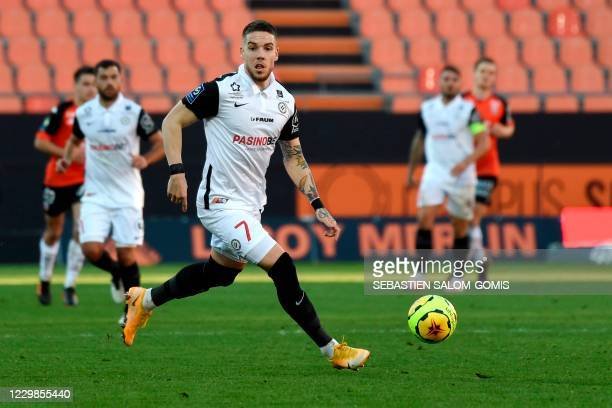 Montpellier's Bosnia and Herzegovina defender Mihailo Ristic runs with the ball during the L1 football match between Lorient and Montpellier at the...