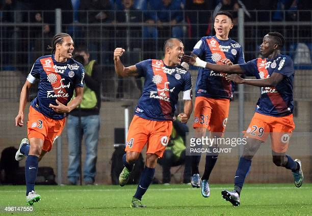 Montpellier's Brazilian defender Vitorino Hilton celebrates with teammates after scoring a goal during the French L1 football match between MHSC...