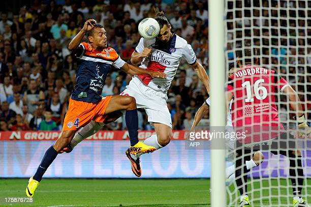 Montpellier's Brazilian defender Vitorino Hilton challenges Paris Saint-Germain's Swedish forward Zlatan Ibrahimovic during the French L1 football...