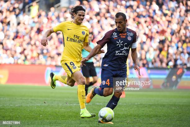 Montpellier's Brazilian defender Vitorino Hilton controls the ball under pressure from Paris SaintGermain's Uruguayan forward Edinson Cavani during...