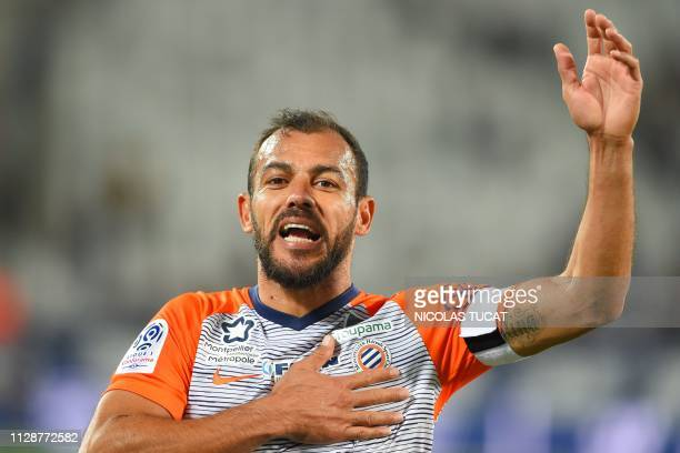 Montpellier's Brazilian defender Vitorino Hilton gestures towards supporters at the end of the French L1 football match between Bordeaux and...