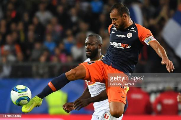 Montpellier's Brazilian defender Vitorino Hilton kicks the ball past Angers' Cameroon forward Stephane Bahoken during the French L1 football match...