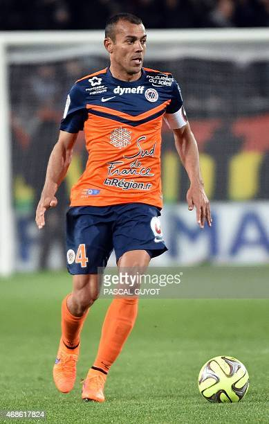 Montpellier's Brazilian defender Vitorino Hilton runs with the ball during the French L1 football match between Montpellier and Bastia on April 04...