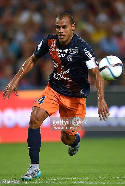 Montpellier's Brazilian defender Vitorino Hilton runs with the ball during the French L1 football match between MHSC Montpellier and Paris Saint...