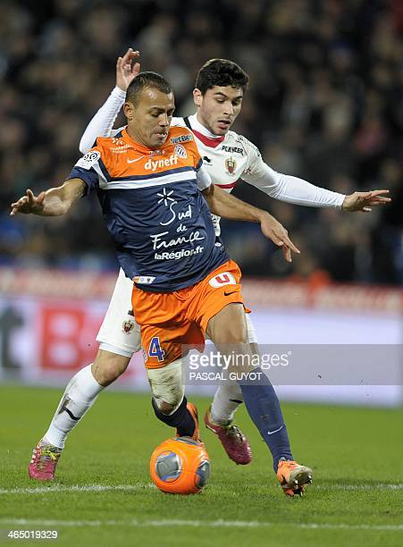 Montpellier's Brazilian defender Vitorino Hilton vies for the ball with Nice's French forward Neal Maupay during the French L1 football match...
