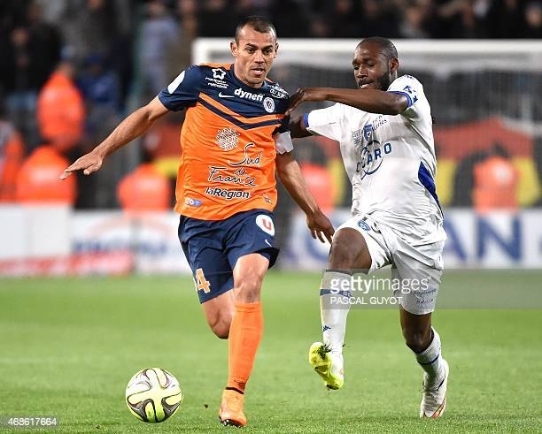 Montpellier's Brazilian defender Vitorino Hilton vies with Bastia's Ivory Cost forward Giovanni SIo during the French L1 football match between...
