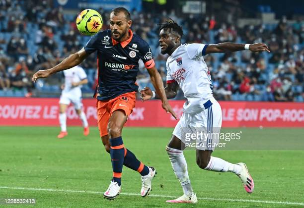 Montpellier's Brazilian defender Vitorino Hilton vies with Lyon's Ivorian forward Maxwell Gnaly Cornet during the French L1 football match between...