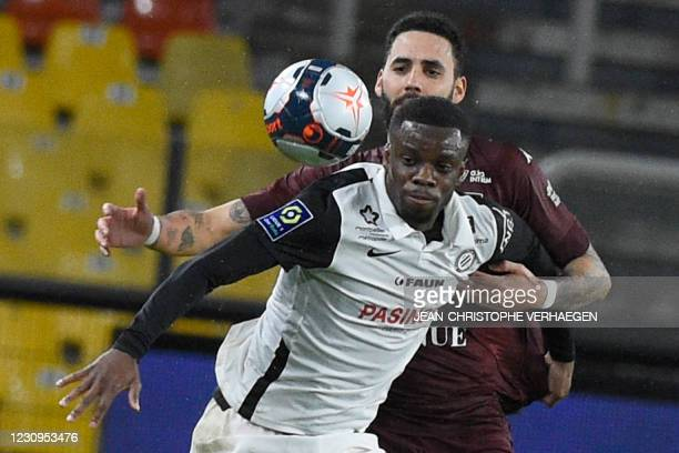 Montpellier's British forward Stephy Mavididi is challenged by Metz's Tunisa defender Dylan Bronn during the French L1 football match between...