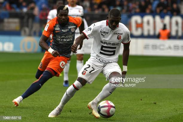 Montpellier's Cameroon midfielder Ambroise Oyongo vies with Rennes' French defender Hamari Traore during the French Ligue 1 football match between...