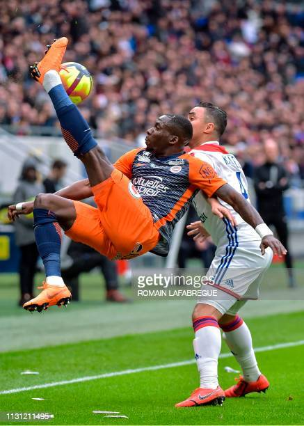 Montpellier's Cameroonian defender Ambroise Oyongo Bitolo vies with Lyon's Brazilian defender Rafael during the French L1 football match between Lyon...