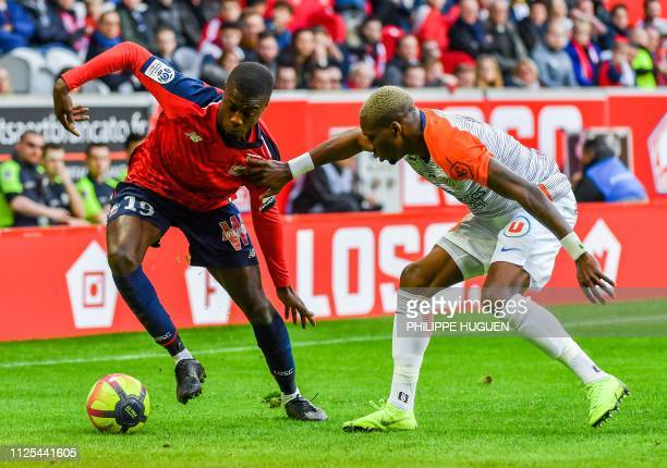 Montpellier's Cameroonian defender Ambroise Oyongo vies for the ball with Lille's Ivorian forward Nicolas Pepe during the French L1 football match...