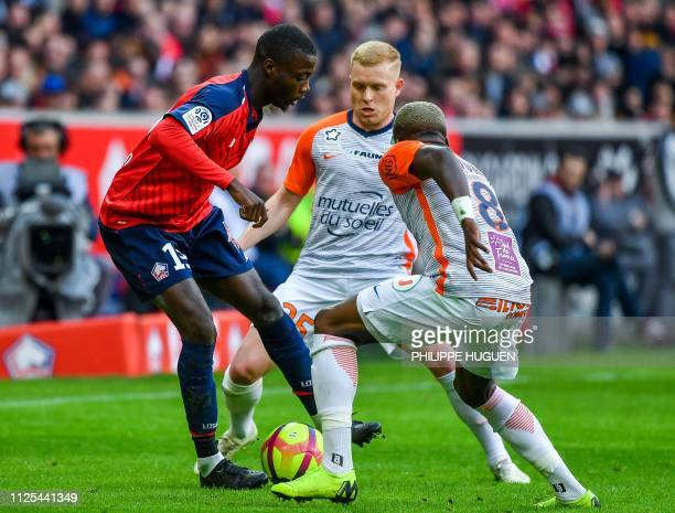 Montpellier's Cameroonian defender Ambroise Oyongo vies with Lille's Ivorian forward Nicolas Pepe during the French L1 football match Lille vs...