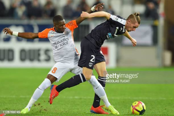 Montpellier's Cameroonian midfielder Ambroise Oyongo vies for the ball with Bordeaux's Croatian midfielder Toma Basic during the French L1 football...