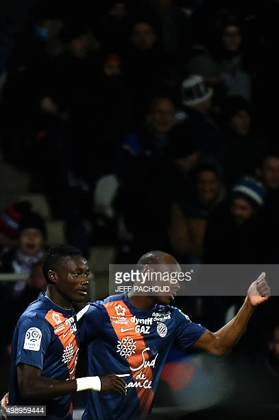 Montpellier's Chadian forward Casimir Ninga celebrates after scoring a goal during the French L1 football match between Lyon and Montpellier at the...