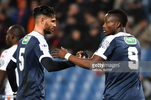 Montpellier's Chadian forward Casimir Ninga is congratulated by his teammate Montpellier's Portuguese defender Pedro Mendes after scoring a goal...