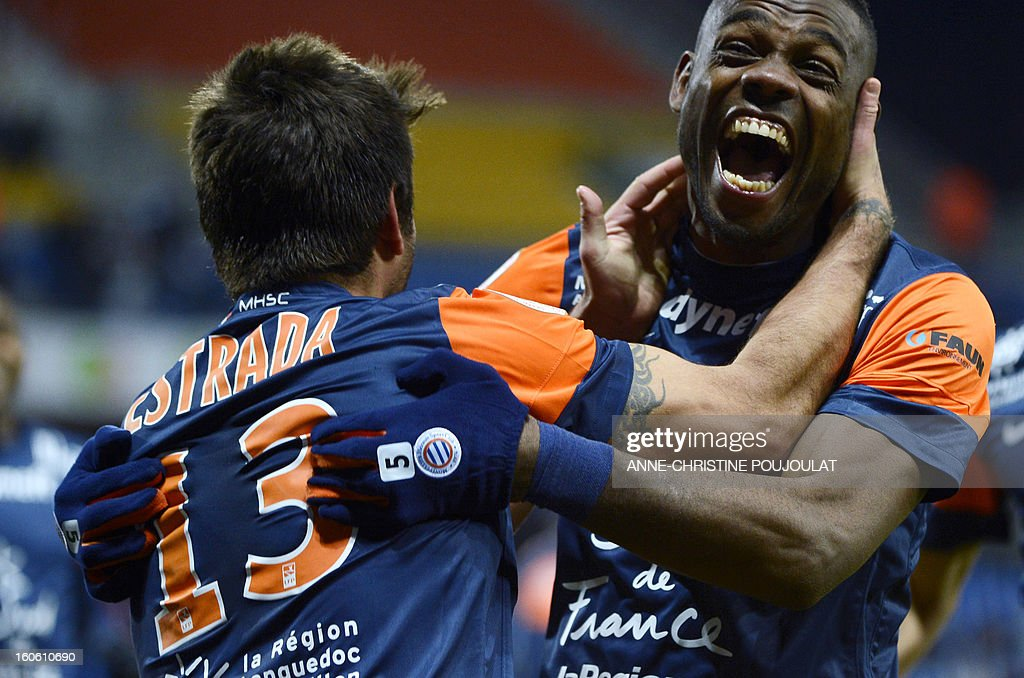 Montpellier's Chilean midfielder Marco Estrada (L) is congratulated by Montpellier's Cameroonian defender Henri Bedimo (R) after scoring during a French L1 football match between Montpellier and Reims on February 3, 2013 at the Mosson stadium in Montpellier, southern France.
