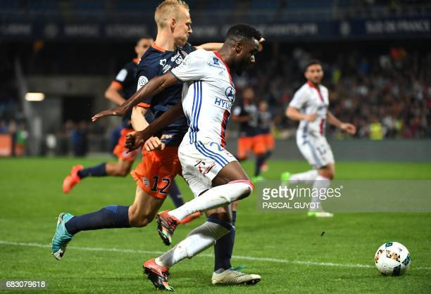 Montpellier's Czech defender Lukas Pokorny vies with Lyon's French forward Maxwel Cornet during the French L1 football match between Montpellier and...