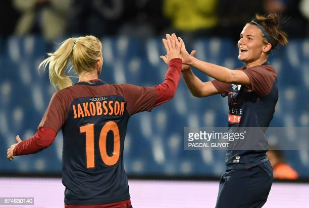 Montpellier's Danish midfielder Katrine Veje and Montpellier's Danish forward Sofai Jakobsson celebrate after scoring a goal during the UEFA Women's...