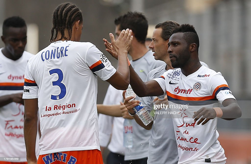Montpellier's defender Siaka Tiene (R) celebrates with French defender Daniel Congré (L) after scoring a goal during the French L1 football match between Nice and Montpellier on September 1, 2013 at the Ray stadium in Nice, southeastern France.
